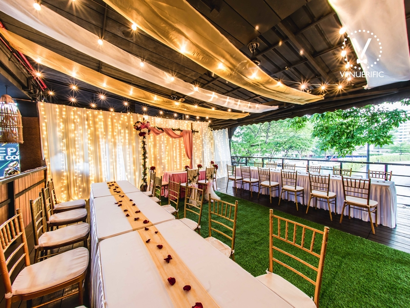 semi outdoor wedding space in singapore with long white table