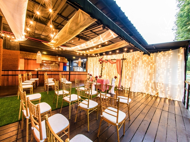 malay wedding set up with wooden domination furniture