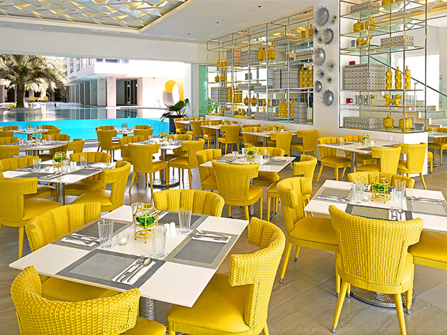 main dining area dominated with yellow furniture and decoration