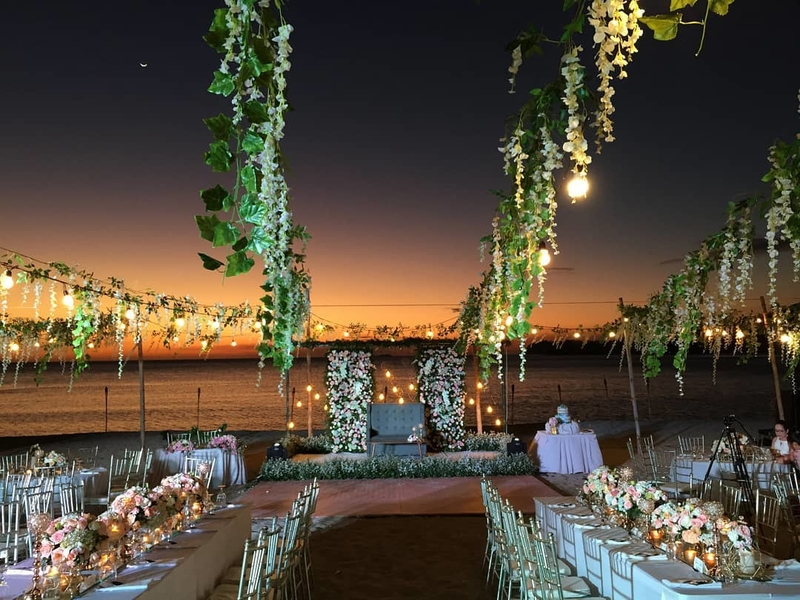 wedding party reception at the beachfront area using long table setup