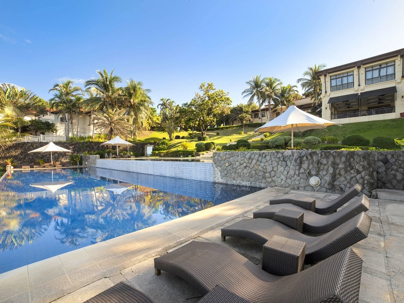 outdoor swimming pool area with green scenery view