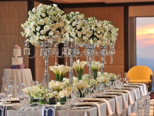 private intimate wedding using long table decorated with flower in high vase