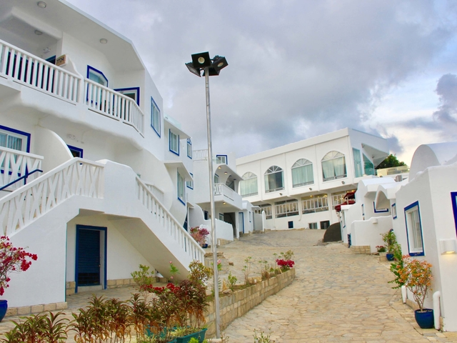 santorini style house in philippines with white theme and small plants surround