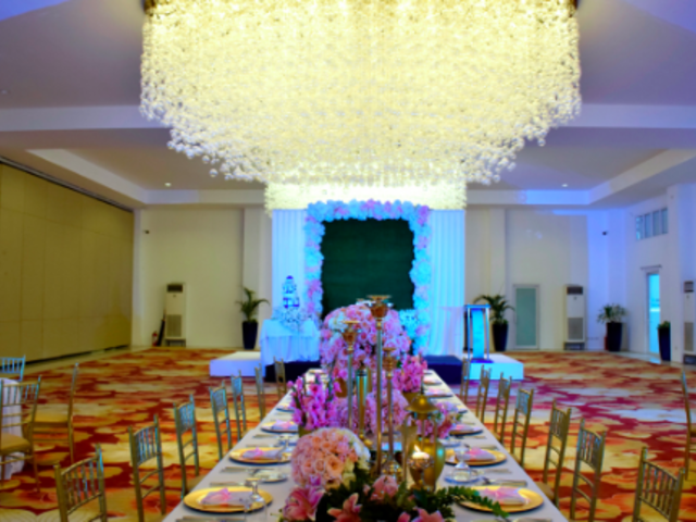 intimate wedding venue with flower decorations and long dining table