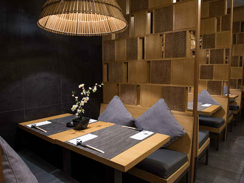 dining cubicles; wooden table and rattan decor