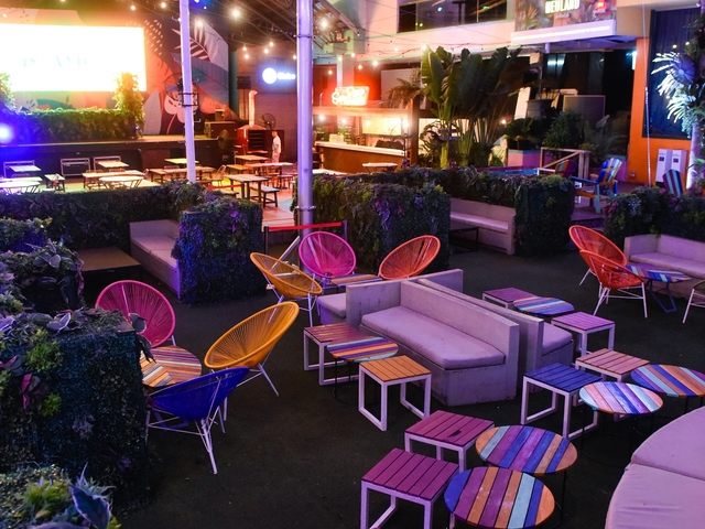 manila outdoor event venue with colourful low chairs and mini garden