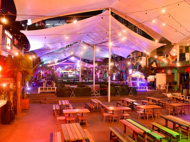 private party space in manila with wooden chairs and white tent