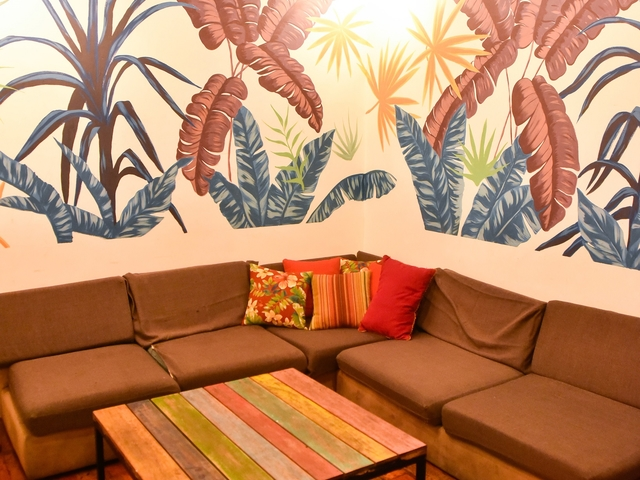 manila small party space with wall painting and long couches