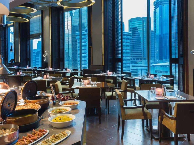 buffet lineup; dining tables overseeing city view