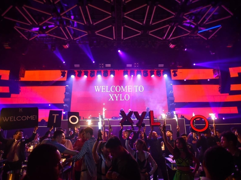 people attending year-end party in philippines event venue with big stage