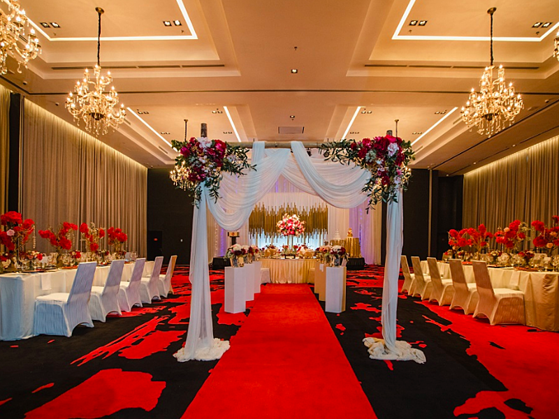kuala lumpur wedding hall with black-red carpet and banquet seating
