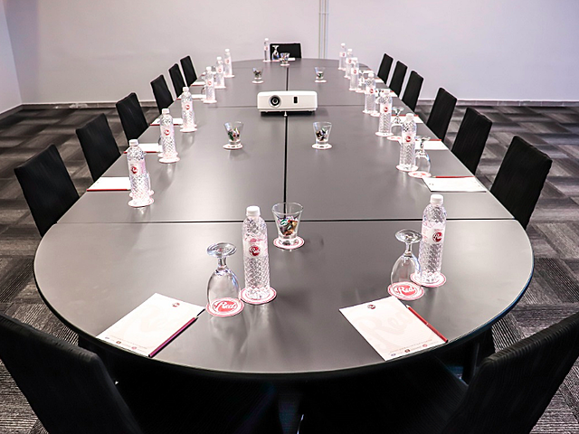 meeting room in kuala lumpur with long table and projector