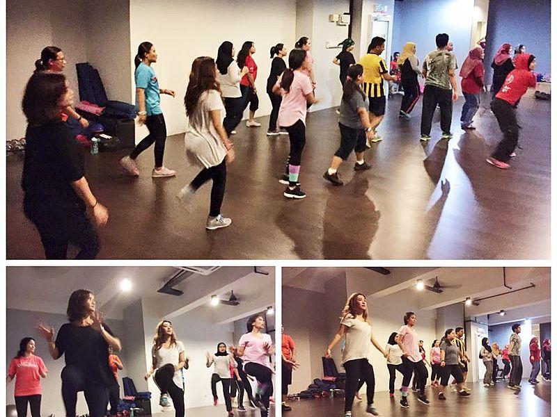 people dancing in zumba class studio petaling jaya