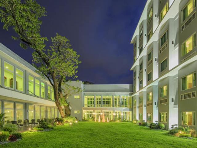 lawn in between hotel buildings