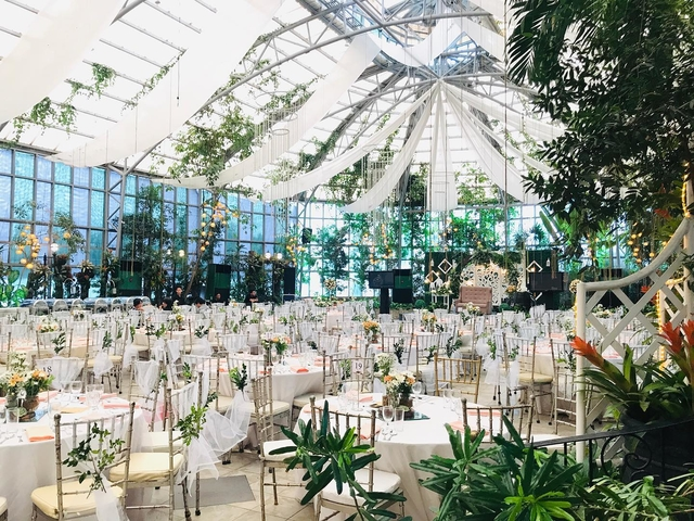 venue with walls of alternating frosted white and green tinted glass