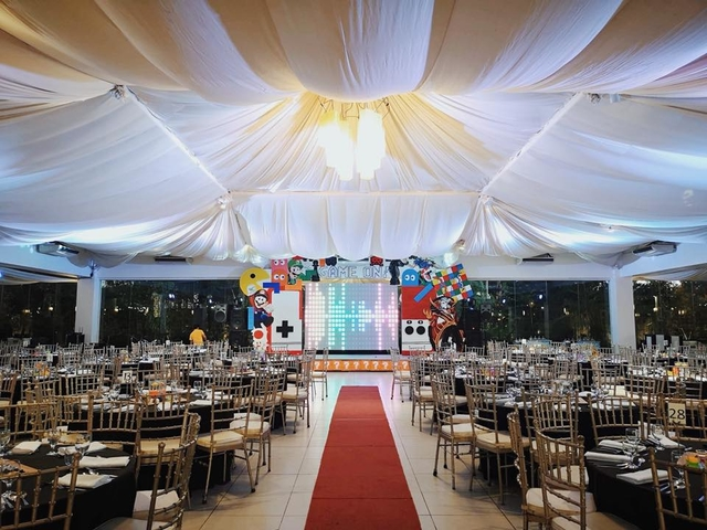 red carpet wedding aisle between guest tables