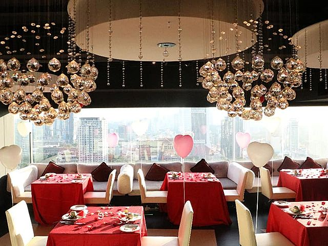 romantic dining restaurant with city view in the day time with natural light