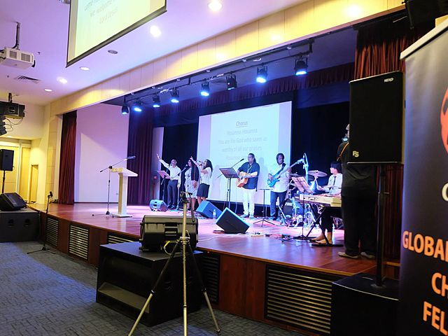 band performance on the stage with lighting
