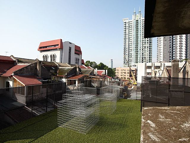 rooftop party space in kuala lumpur with city view and artificial grass