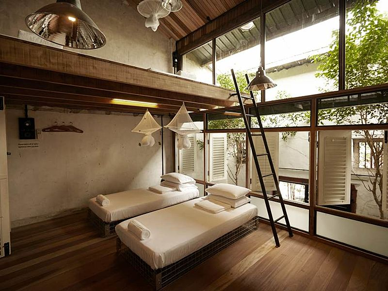 boutique hotel with minimalist duplex room and wooden windows in penang