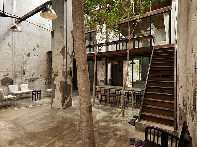 semi-outdoor product launch venue in penang with trees and bedrooms