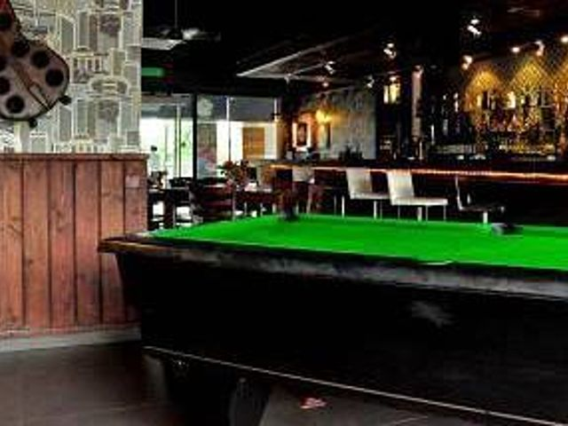 pool table nearby the bar area by bulls eye pub and restaurant