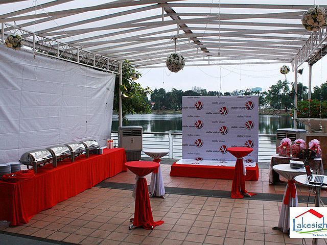 outdoor corporate event set up beside lake