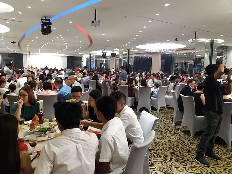 people enjoying food while dining party in the 600 capacity event space
