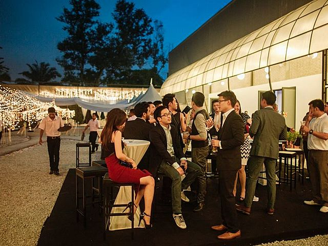 people attending cocktail party event in outdoor venue Kuala lumpur