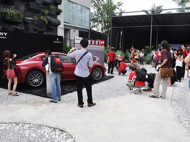 people attending car launch event in outdoor venue kuala lumpur