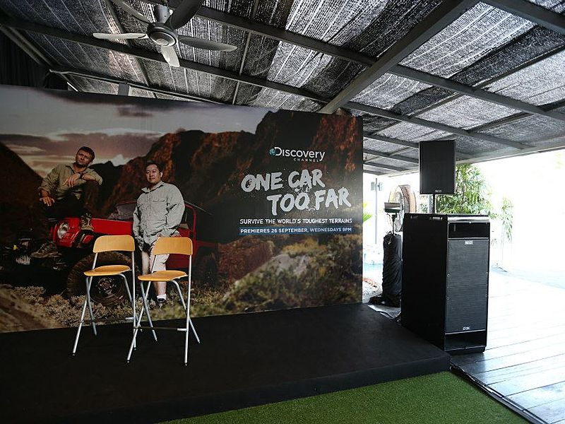 semi-outdoor venue in kuala lumpur with mini stage and large backdrop