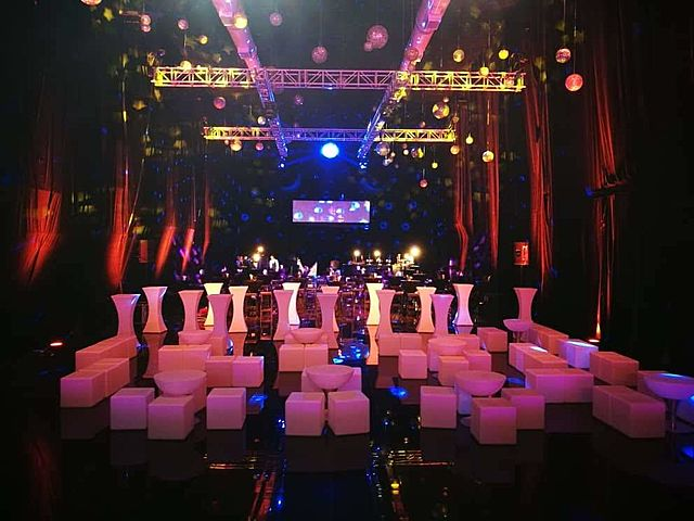 indoor year-end party venue with stage and cocktail table