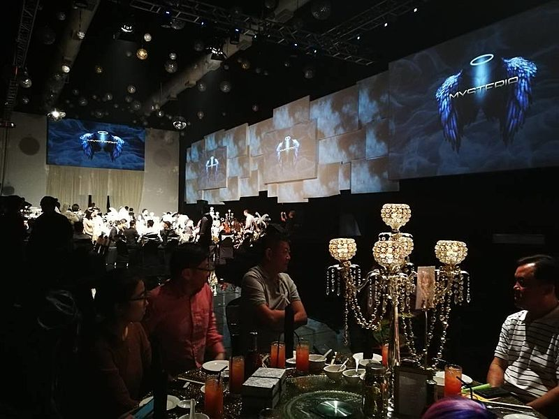 high-ceiling function hall with large led screen and banquet seating
