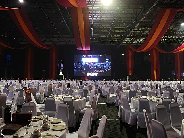 white table set up with huge stage
