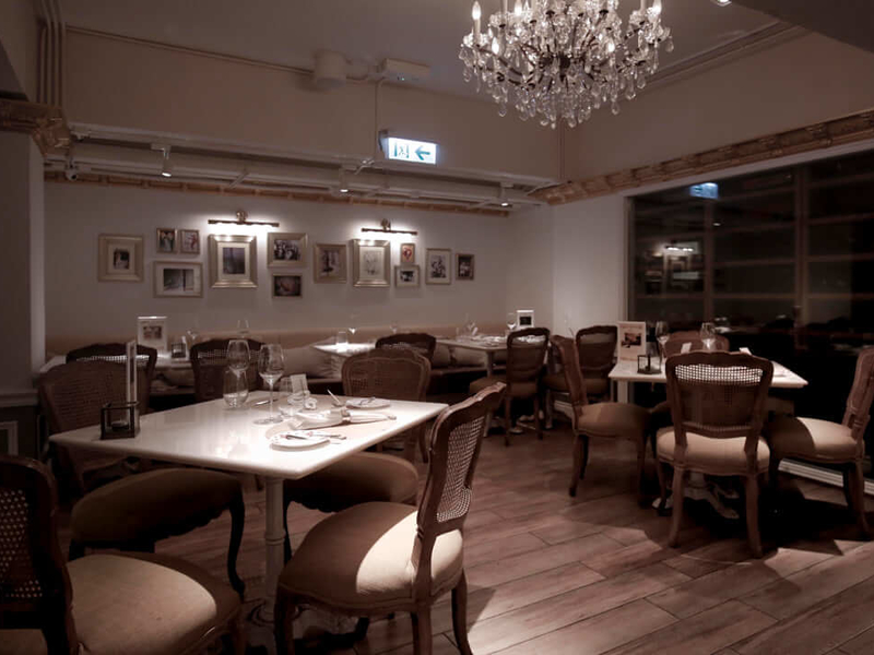 dining tables within restaurant with chandelier