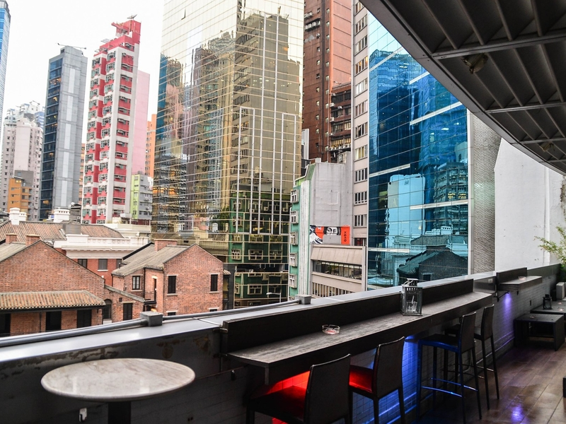 spacious terrace with bar seating and panoramic view of hong kong city