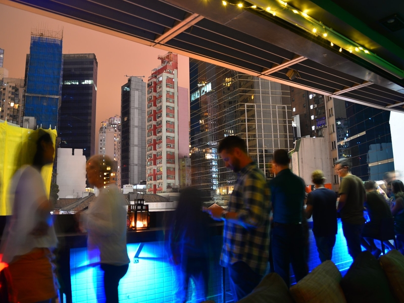 people are enjoying the happy hour and hon kong's view all the night