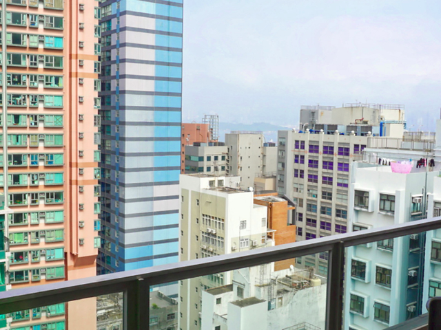 open space area at the coworking with the view of honh kong cirt