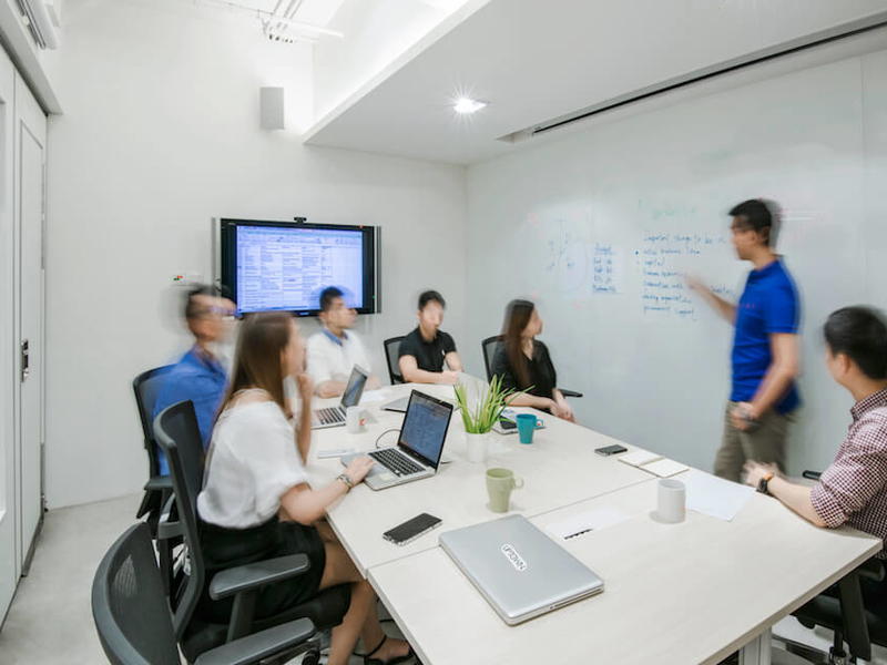company team is doing their meeting at the private meeting room