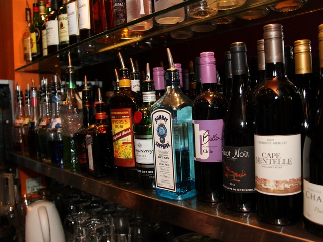 large selection of alcoholic drinks on the shelf