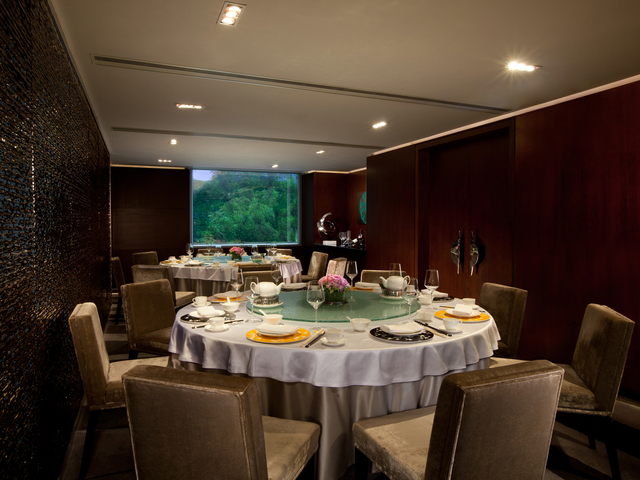 private room with banquet style and window with outside view