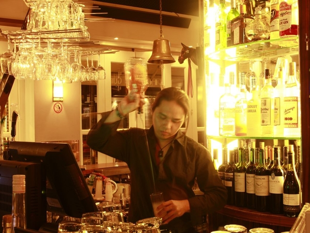busy bartender mixing drinks in typhoon bar