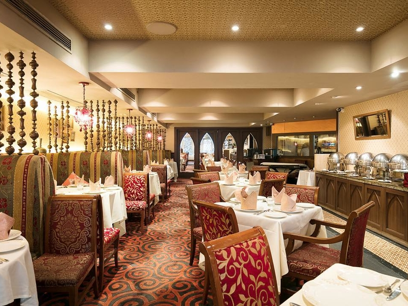 authentic and local indian restaurant dominated with red and gold colour of interior