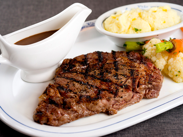 beef steak served with mashed potatoes and mushroom sauce