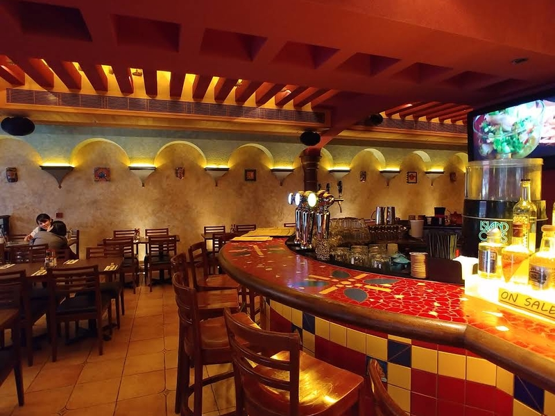 indoor mexican restaurant with sit down table and bar area