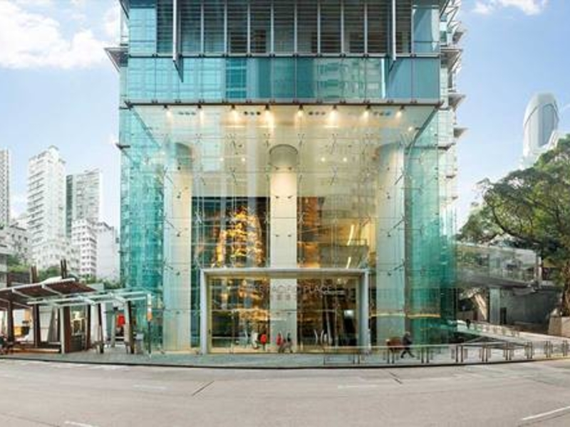 the exterior building of three pasific place dominated with glass