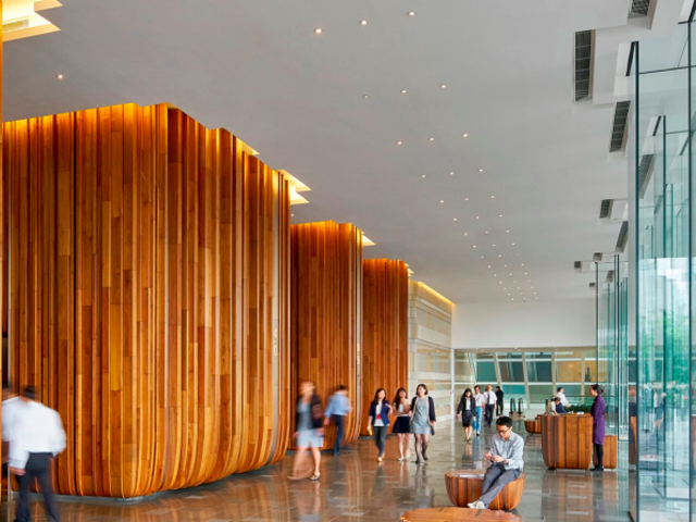 the crowded lobby of three pacific place using big wooden pillars