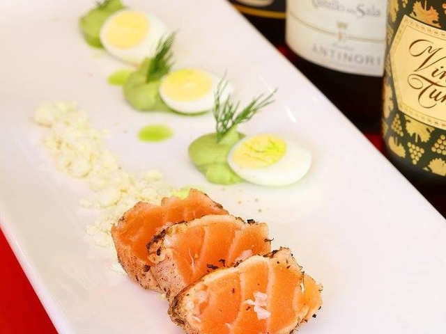 salmon appetizer served on the plate with garnish