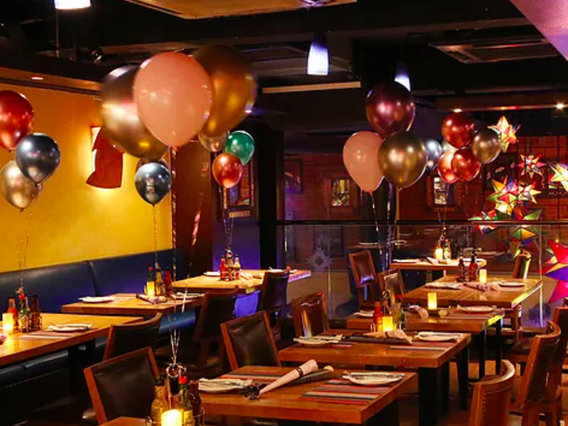 private room decorated with balloons to celebrate birthday party