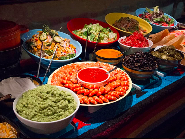 mexican buffet food served on the table for party event
